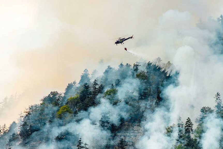 Helicopter extinguishing a forest fire