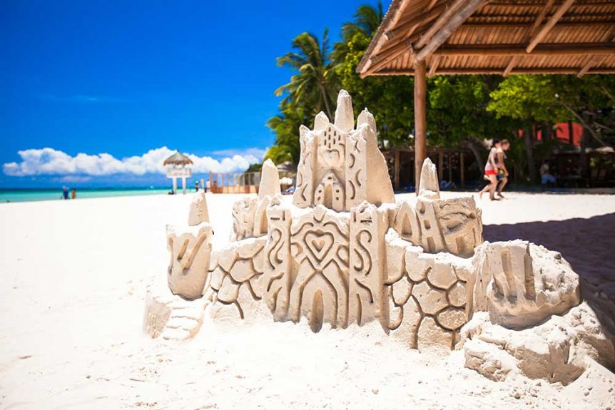 Sandcastle on tropical beach